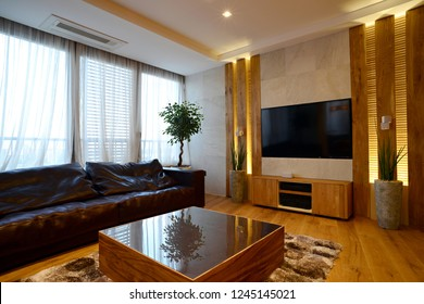 Leather sofa big window tv set in guest room interior