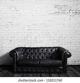 leather sofa in brick room