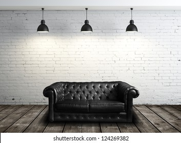 leather sofa in brick room and three lamps