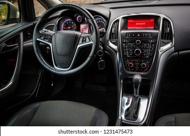 Leather steering wheel and stylish dashboard inside the car