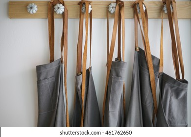 leather strap apron hanging on the wall in coffee shop bangkok thailand