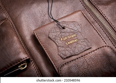 Leather tag with Full Grain Leather text embossed in gold