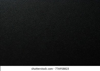 Leather texture.Black dark leather background. Photo of cloth material.