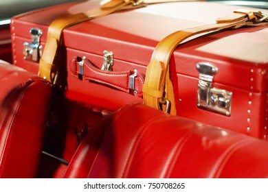 Leather travel bags fixed in the car and ready to travel. Active leisure concept.Vintage style