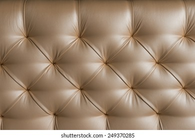 Leather upholstery. Background of expensive furniture. The texture of quilted furniture.