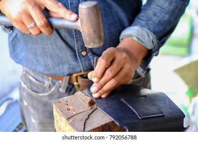 Leather worker are working outdoor.