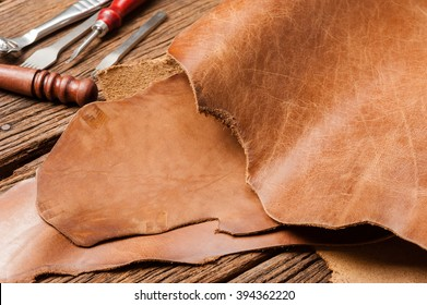 leather working, closeup details of brown leather