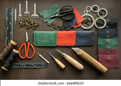 Leathersmith's work desk . Leather working tools on a work table