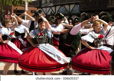 LEAVENWORTH, WA - MAY 12: A group of dancers perform German folk dance on front street during a 40 Th annual Mai-fest celebration in Leavenworth, Washington, USA