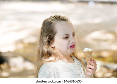 It leaves a bad taste in the mouth. Cute little girl dislike taste of ice cream. Small child licking ice cream with unpleasant taste impression. Her ice-cream just doesnt taste as good.