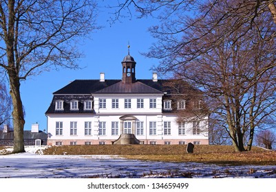 Leaves and Sorgenfri Palace during a sunny winter day, which is a royal residence of the Danish monarch located in Greater Copenhagen