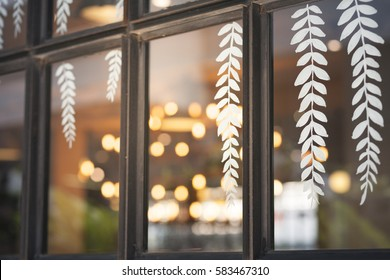Leaves Sticker decoration on window with bokeh light background