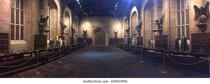 Leavesden, London – March 2017: Dining room setting at the Warner Brothers Studio tour 'The making of Harry Potter' and the bus. A behind the scenes, editorial only, soft focus, panoramic view