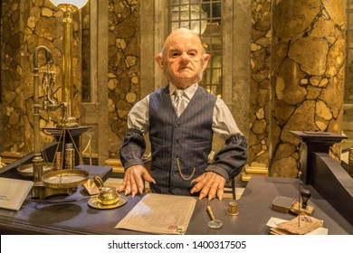 Leavesden, London, UK - May 2019: Warner Bros. Studio Tour 'The Making of Harry Potter', Goblin cashier in Gringotts Bank, props and costumes used in the production of the films