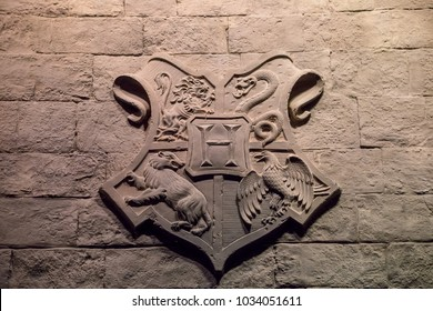 LEAVESDEN, UK - FEBRUARY 24TH 2018: Crest of Hogwarts School at the Making of Harry Potter tour at Warner Bros studio in Leavesden, UK