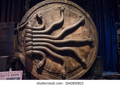 LEAVESDEN, UK - FEBRUARY 24TH 2018: Snakes on Chamber of Secrets door at the Making of Harry Potter tour at Warner Bros studio in Leavesden, UK