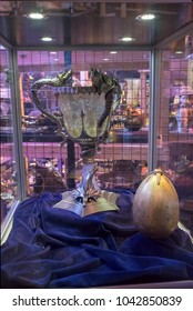 LEAVESDEN, UK - FEBRUARY 24TH 2018: TriWizard cup and golden egg on display at the Making of Harry Potter tour at Warner Bros studio in Leavesden, UK