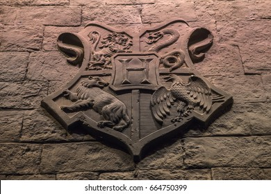 LEAVESDEN, UK - JUNE 19TH 2017: The Hogwarts crest on the set of the Great Hall at Hogwarts, at the Making of Harry Potter studio tour at the Warner Bros studios in Leavesden, UK, on 19th June 2017.