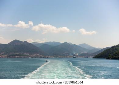 Leaving Igoumenitsa harbor by ship in the summer