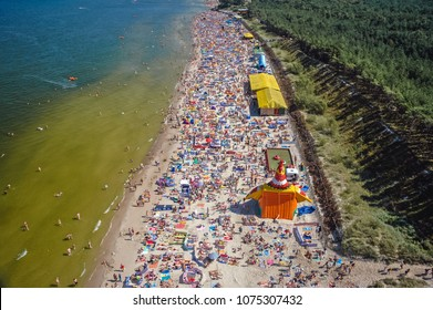 Leba, Poland - August 15, 2005: Aerial view of beach full of tourists in Leba, famous Baltic Sea coastal summer town in Poland