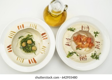 Lebanese appetizers of Hummus and eggplant dip with olive oil isolated on white