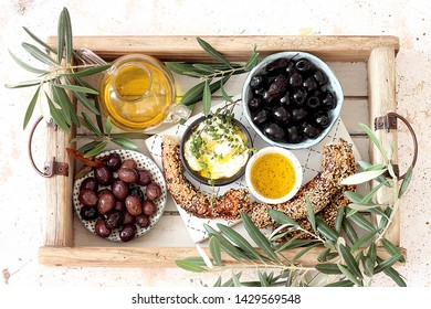 Lebanese  cheese cream dip with olive oil , bread and olives.Top view