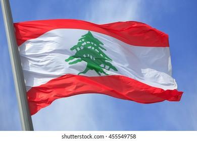 The Lebanese flag against the blue sky