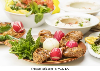 Lebanese food of kibbeh nayyeh, Hummus and Fresh Salad, Close Up
