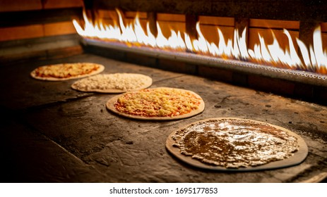 Lebanese food Manakish  baked in the oven oven - Shutterstock ID 1695177853