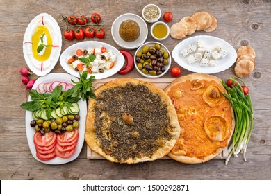 Lebanese food of Manakish, Lbaneh, cheeses, Vegetables and olives  - Shutterstock ID 1500292871