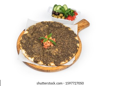 lebanese Manoushe ,bread of thyme topped with mint, tomatoes and veggies; Lebanese Zaatar Manouche; zaatar flat bread, Clipping path included