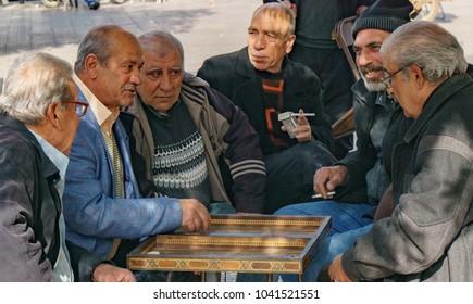 Lebanese old men playing backgammon in the street of Tripoli Lebanon 5 february 2018