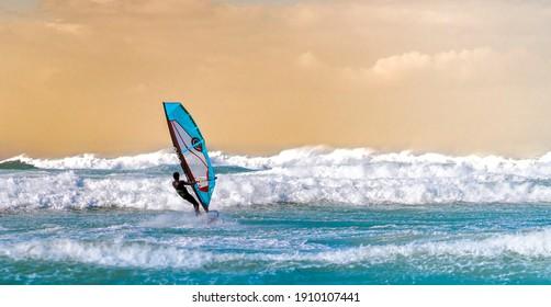 Lebanon, Batroun - 23 December 2019: Windsurfer on a good winter day riding waves.