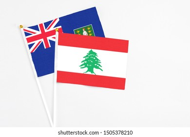 Lebanon and British Virgin Islands stick flags on white background. High quality fabric, miniature national flag. Peaceful global concept.White floor for copy space.
