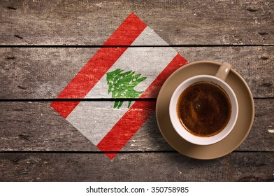 Lebanon flag with coffee on table. top view