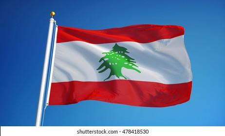 Lebanon flag waving against clean blue sky, close up, isolated with clipping path mask alpha channel transparency