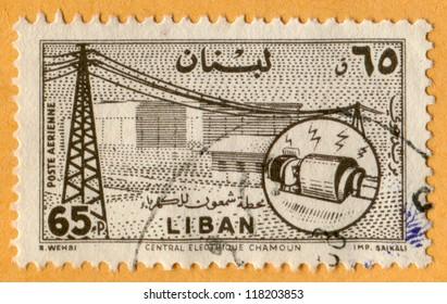 Lebanon (Liban) - CIRCA 1957: stamp printed in Lebanon shows Chamoun Electric Power, Scott catalog C252 AP60 65p sepia (dark brown), circa 1957