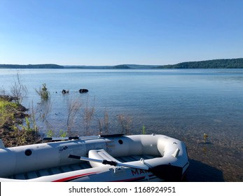 LEBANON, NJ - June 30, 2018: inflatable boat with paddles on the shore of Round Valley Reservoir known for its pristine clear blue waters.