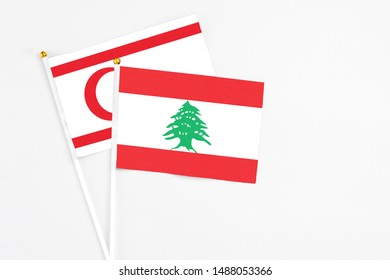 Lebanon and Northern Cyprus stick flags on white background. High quality fabric, miniature national flag. Peaceful global concept.White floor for copy space.