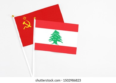 Lebanon and Soviet Union stick flags on white background. High quality fabric, miniature national flag. Peaceful global concept.White floor for copy space.