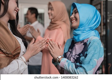 Lebaran homecoming in his hometown greet each other apologizing with friends during the Eid