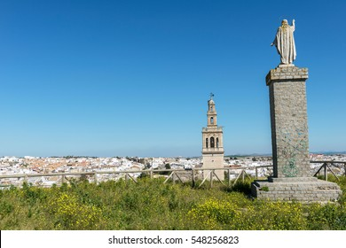 LEBRIJA, ANDALUSIA, SPAIN - FEBRUARY 2014: City view of the town Lebrija with the church tower of Santa Maria de Oliva in the background.