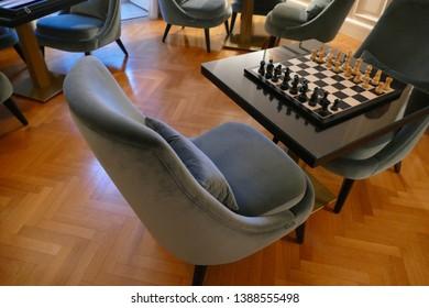 LECCE, ITALY - APR 6, 2019 - Chess table in a luxury hotel study, La Fiermontina Hotel, Lecce, Puglia, Italy