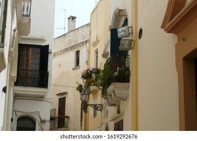 LECCE, ITALY - APR 6, 2019 - Iron balconies in narrow streets of Gallipoli, Puglia, Italy