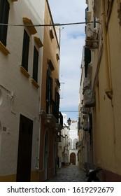 LECCE, ITALY - APR 6, 2019 - Narrow street of Gallipoli, Puglia, Italy
