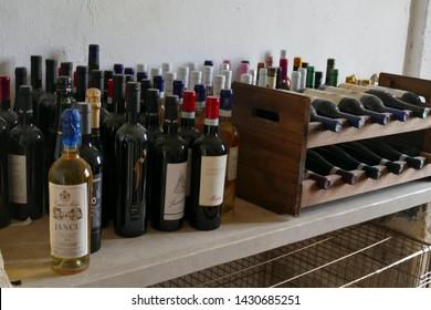 LECCE, ITALY - APR 7, 2019 - Wine bottles on display in the masseria of Tenuta  Mose villa near Lecce, Puglia, Italy