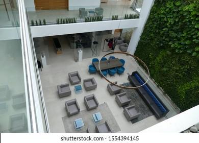 LECCE, ITALY - APR 8, 2019 - Modern furniture in sitting area of Palazzo de Noha, Lecce, Puglia, Italy