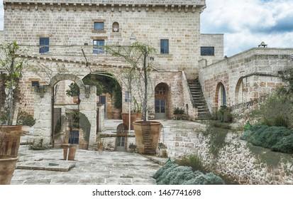 LECCE, ITALY - APR 9, 2019 - Courtyard of a luxury boutique hotel, Masseria Trapana, Lecce, Puglia, Italy