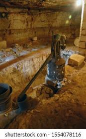 LECCE, ITALY - APR 9, 2019 - Vintage olive oil mill and grindstone at Antica Masseria Brancati,Lecce, Puglia, Italy