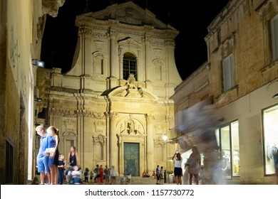 Lecce, Italy - August 15, 2018, people stroll in the evening in the historic center of Lecce in southern Italy.